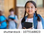 smiling student girl wearing... | Shutterstock . vector #1075168823