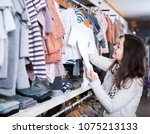 young smiling female customer... | Shutterstock . vector #1075213133