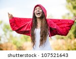 Woman In Raincoat Enjoying The...