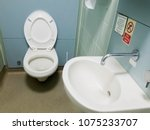 public toilet with a toilet and ... | Shutterstock . vector #1075233707
