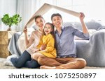 mother  father and children... | Shutterstock . vector #1075250897