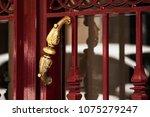 an antique bronze doorknob....   Shutterstock . vector #1075279247