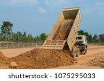 dump truck unloading soil or... | Shutterstock . vector #1075295033