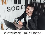 a young  handsome businessman... | Shutterstock . vector #1075315967