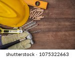 hammer  protective gloves ... | Shutterstock . vector #1075322663