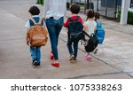 mother and pupil and kids...   Shutterstock . vector #1075338263