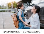 mother dressing up a son and... | Shutterstock . vector #1075338293