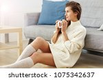 happy woman relaxing at home | Shutterstock . vector #1075342637