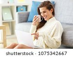 happy woman relaxing at home... | Shutterstock . vector #1075342667