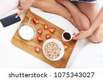 young woman in bed with... | Shutterstock . vector #1075343027