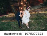 a stylish bridegroom rolls the... | Shutterstock . vector #1075377323