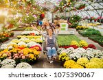 two pretty playful florist... | Shutterstock . vector #1075390067