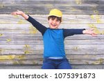 portrait of a cute cheerful boy ... | Shutterstock . vector #1075391873
