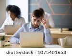 shocked businessman stunned by... | Shutterstock . vector #1075401653
