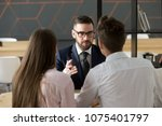serious investment broker ... | Shutterstock . vector #1075401797