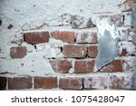Small photo of Wall deteriorated with bricks