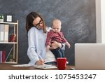 happy mother working at office... | Shutterstock . vector #1075453247