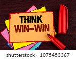 Small photo of Conceptual hand writing showing Think Win-Win. Business photo showcasing Negotiation strategy for both partners to obtain benefits written on Sticky note paper on wooden background Marker.