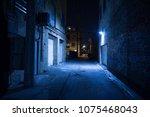 dark and eerie urban city alley ... | Shutterstock . vector #1075468043