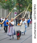 Small photo of ZURICH - AUGUST 1: Swiss National Day parade on August 1, 2009 in Zurich, Switzerland. Traditional alphorn musicians in a historical costumes.