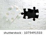 close up piece of white jigsaw...   Shutterstock . vector #1075491533