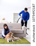 husband cleaning house from dog ... | Shutterstock . vector #1075492187
