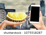 buy durian fruit on mobile | Shutterstock . vector #1075518287