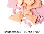 broken pink and orange eyeshadow isolated on white background - stock photo