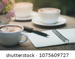 pen and small notebook on wood... | Shutterstock . vector #1075609727