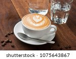 latte art with wood background | Shutterstock . vector #1075643867