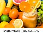 jar of milkshake with tropical... | Shutterstock . vector #1075668647