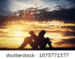 sad couple sitting back to back ... | Shutterstock . vector #1075771577