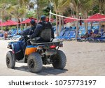 security guards on a beach.   Shutterstock . vector #1075773197
