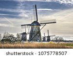 predominantly blue and sunny... | Shutterstock . vector #1075778507