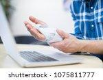 close up of businessman using... | Shutterstock . vector #1075811777