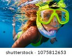 happy girl in snorkeling mask... | Shutterstock . vector #1075812653