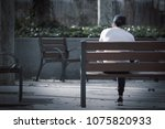 depressed  young man sitting on ... | Shutterstock . vector #1075820933