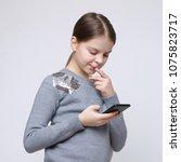 school teen girl holding mobile ... | Shutterstock . vector #1075823717