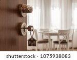 open door to a new home. door...   Shutterstock . vector #1075938083