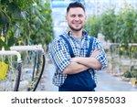 waist up portrait of cheerful...   Shutterstock . vector #1075985033