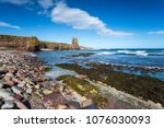 blue skies over the ruins of... | Shutterstock . vector #1076030093