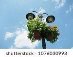 colorful flower pots hanging...   Shutterstock . vector #1076030993