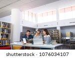 university students working in...   Shutterstock . vector #1076034107