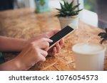 handsets use smartphones to...   Shutterstock . vector #1076054573