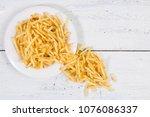 sticks of french fries on white ... | Shutterstock . vector #1076086337