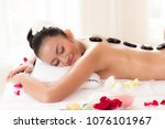 hot stones and massage in spa...   Shutterstock . vector #1076101967