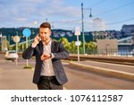 a handsome young businessman... | Shutterstock . vector #1076112587