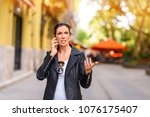 a young woman being upset while ... | Shutterstock . vector #1076175407