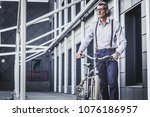 businessman with bicycle. shot... | Shutterstock . vector #1076186957