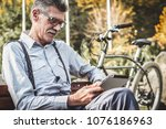 reading the news. side view of... | Shutterstock . vector #1076186963